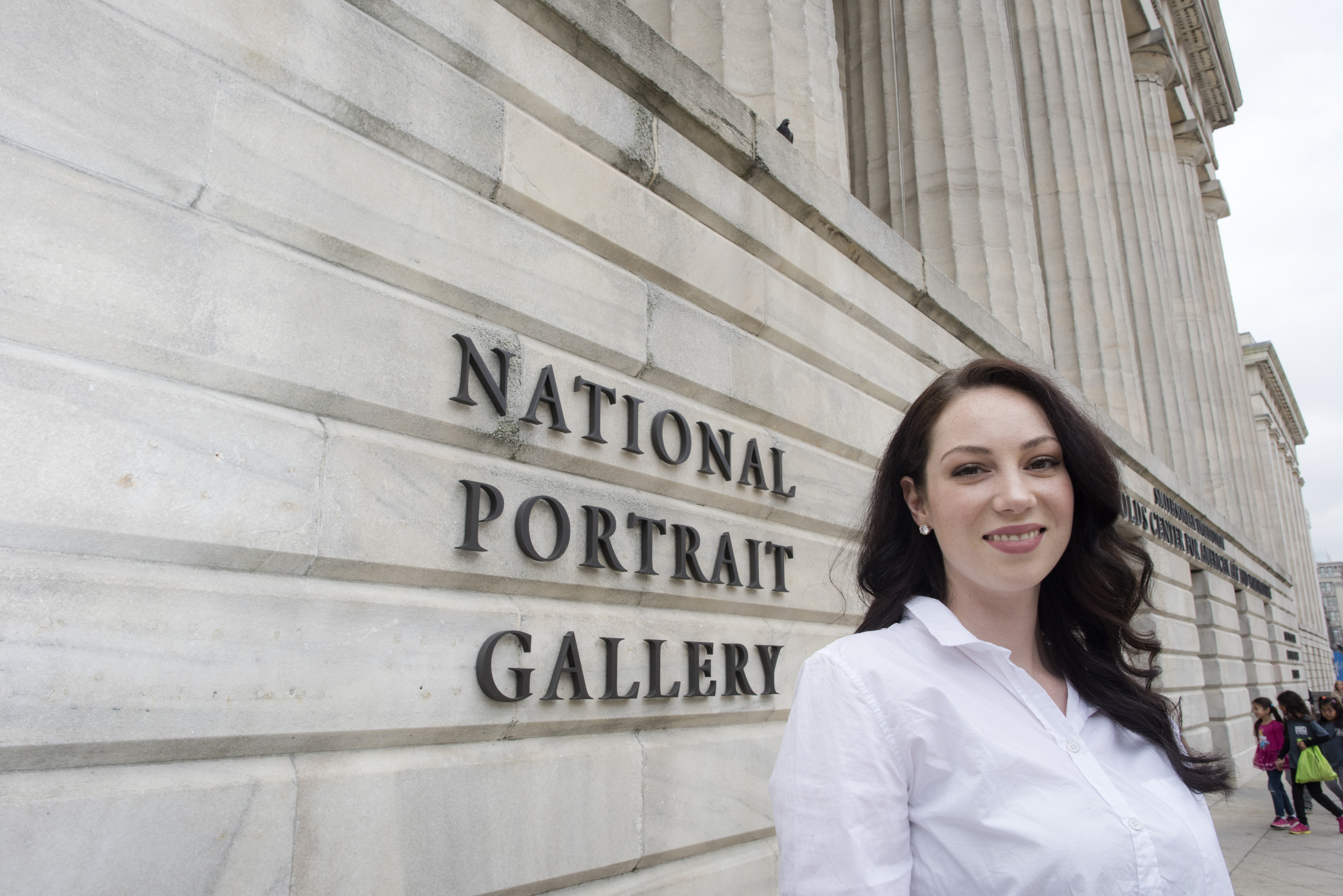 Mason graduate student Ina Descartes in front of the National Portrait Gallery