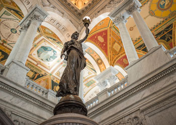 Interior of the Library of Congress with statue holding light