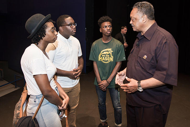 Jesse Jackson talks with Mason students on the Fairfax Campus